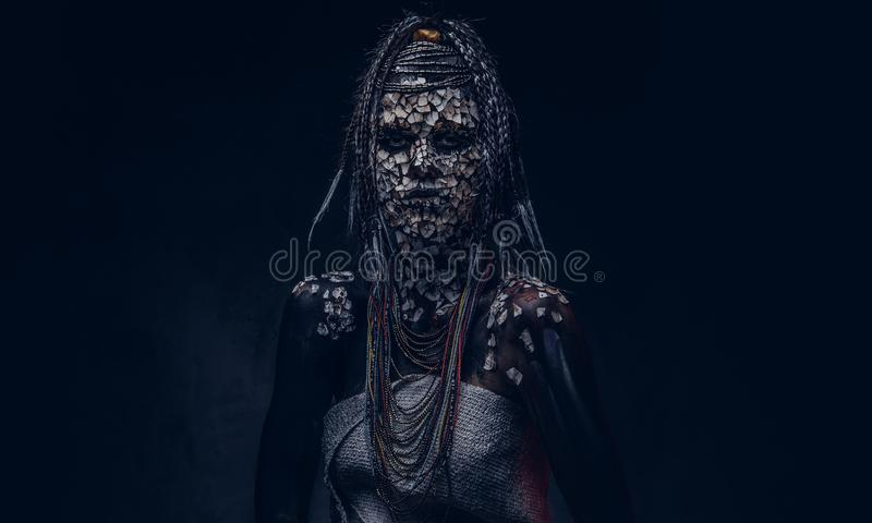 Close-up portrait of a witch from the indigenous African tribe, wearing traditional costume. Make-up concept. royalty free stock images