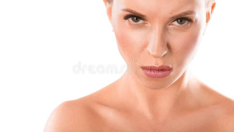 Close up portrait of a woman with an angry face. Isolated on white. Facial expressions and emotions. royalty free stock photography