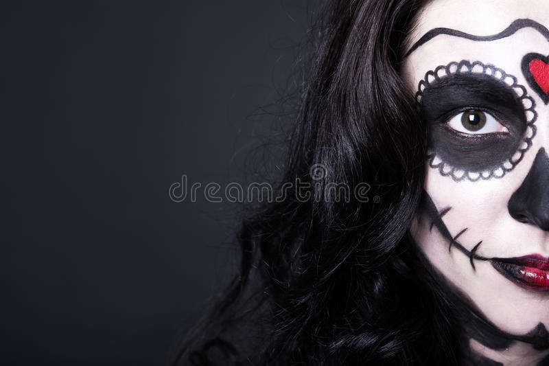 close up portrait of woman with Halloween skull make up over black royalty free stock photos