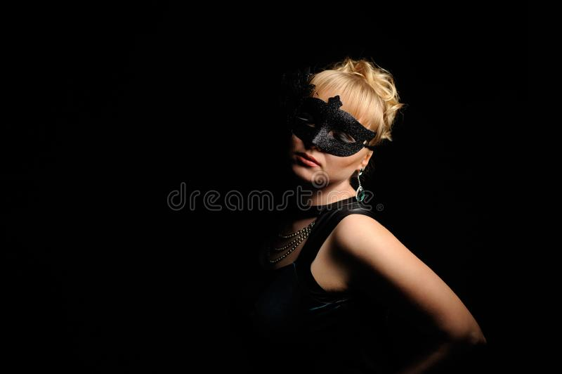 Close up portrait of woman in mysterious mask stock images
