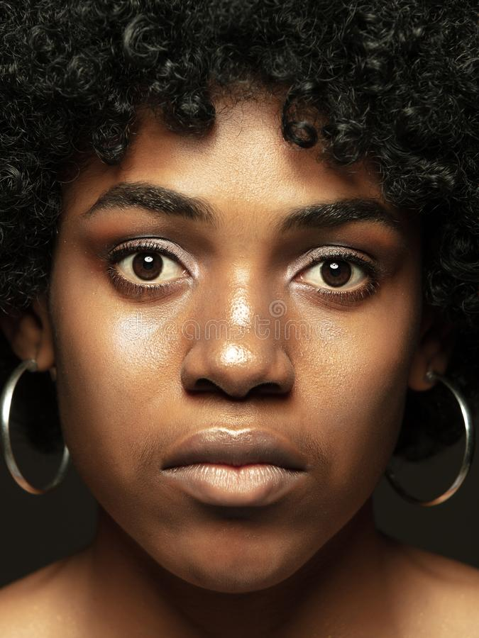 Close up portrait of young african-american emotional girl stock image
