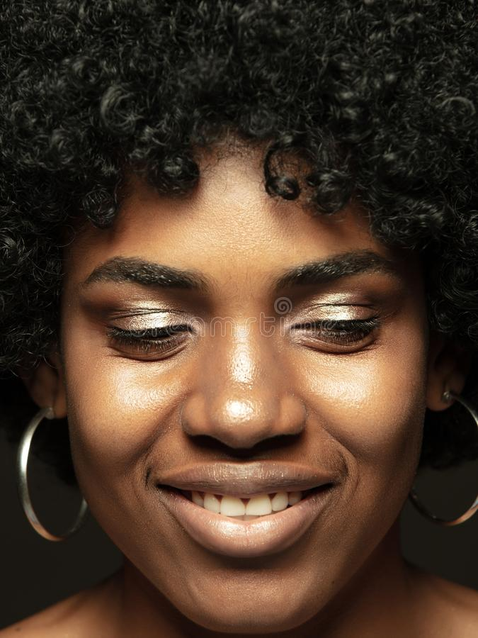 Close up portrait of young african-american emotional girl stock photo