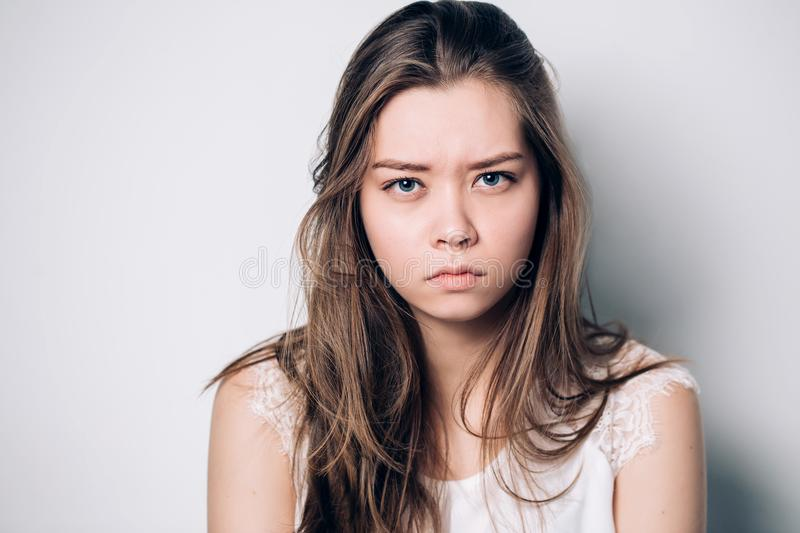 Close up portrait of young annoyed angry woman. royalty free stock image