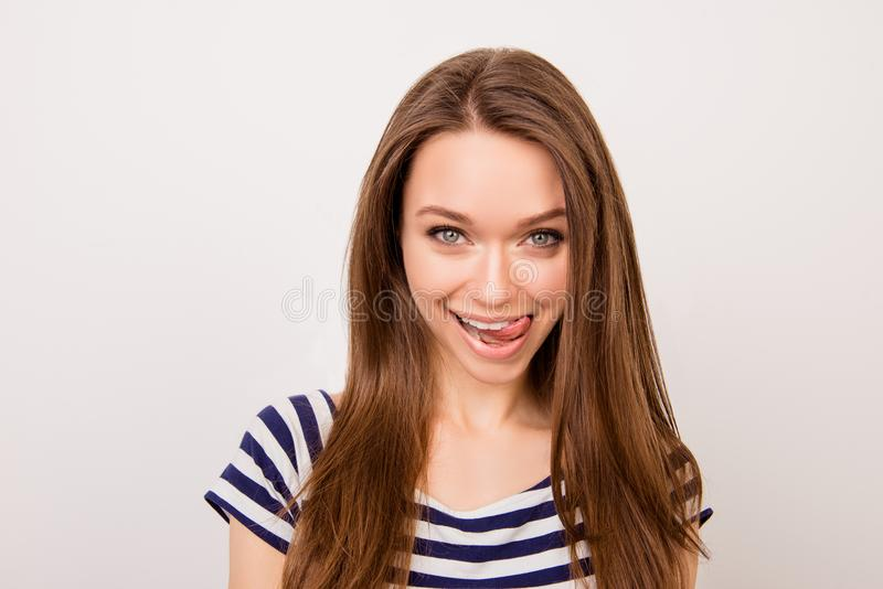 Close up portrait of young attractive woman with long hair seductively licking her lips royalty free stock image