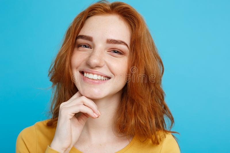 Close up Portrait young beautiful attractive redhair girl smiling looking at camera. Blue Pastel Background. royalty free stock photos