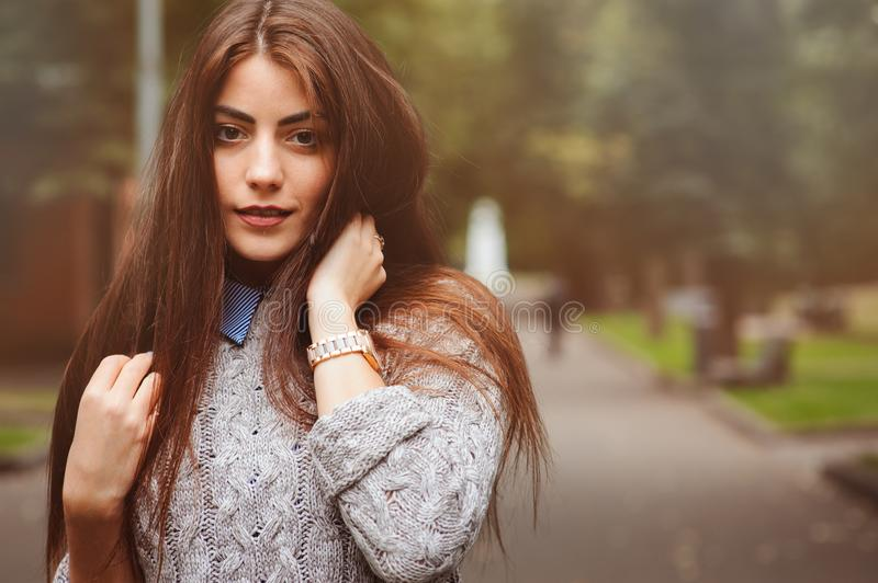Close up portrait of young beautiful happy girl with well conditioned long dark hair royalty free stock images