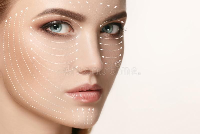 Close-up portrait of young, beautiful and healthy woman with arrows on her face stock image