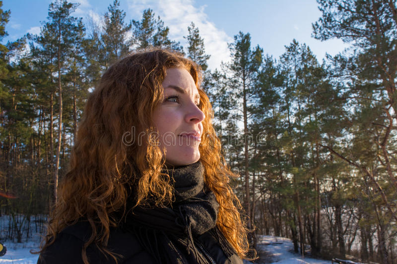 Close up portrait of a young beautiful red hair european girl in the winter forest royalty free stock photos