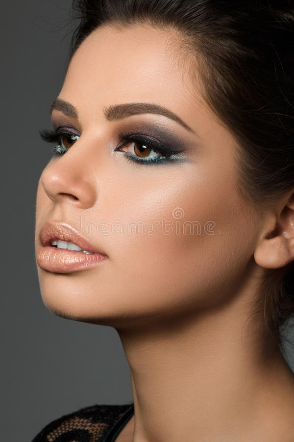 Close-up portrait of young beautiful tanned woman royalty free stock images