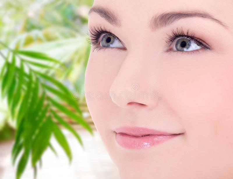 Close up portrait of young beautiful woman over spring background royalty free stock photography
