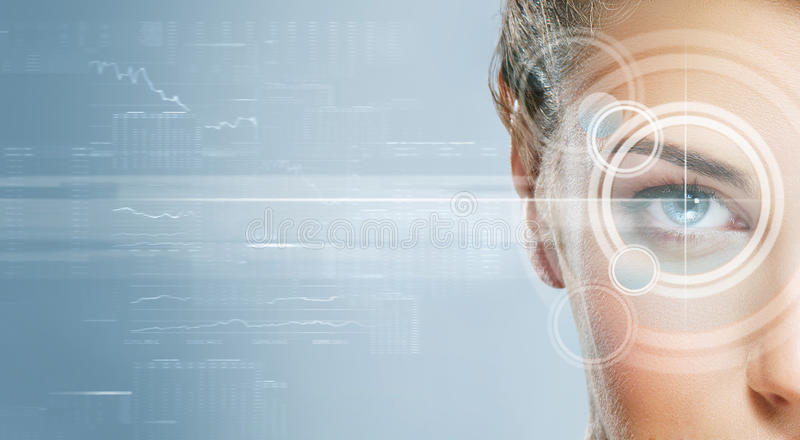 Close-up portrait of young and beautiful woman with the virtual. Hologram on her eyes (laser medicine and security technology concept