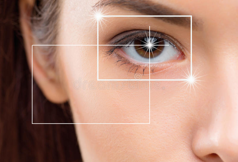 Close-up portrait of young and beautiful woman with the virtual hologram on her eyes stock image