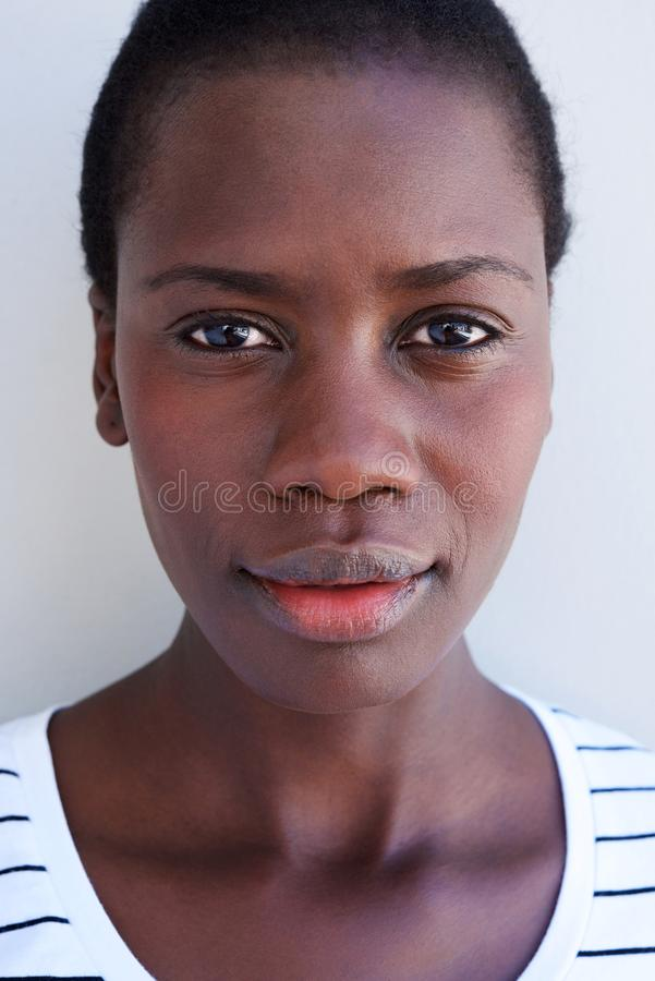 Close up beautiful young african woman face with serious expression stock image
