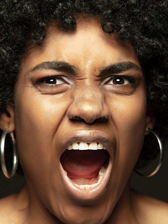 Close up portrait of young african-american emotional girl stock photos