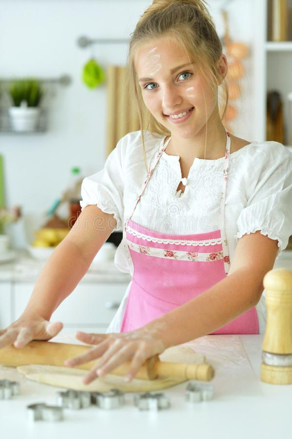 Portrait of young girl baking in the kitchen. Close up portrait of young girl baking in the kitchen stock photography