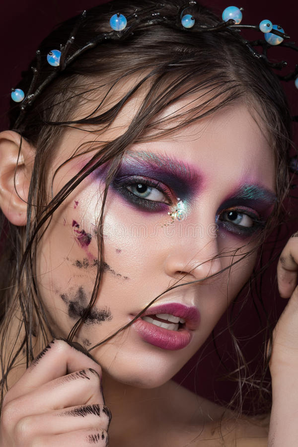 Close-up portrait of a young girl with fashion creative make-up stock photography