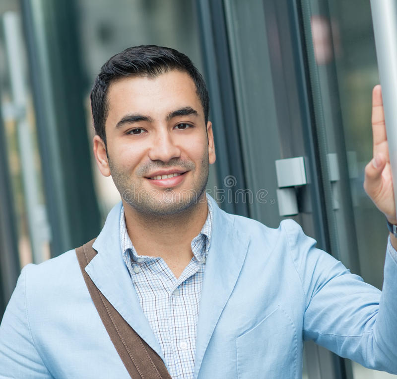 Close up portrait of young gorgeous man. Outdoor - outside. Smiling hispanic guy looking to camera royalty free stock images
