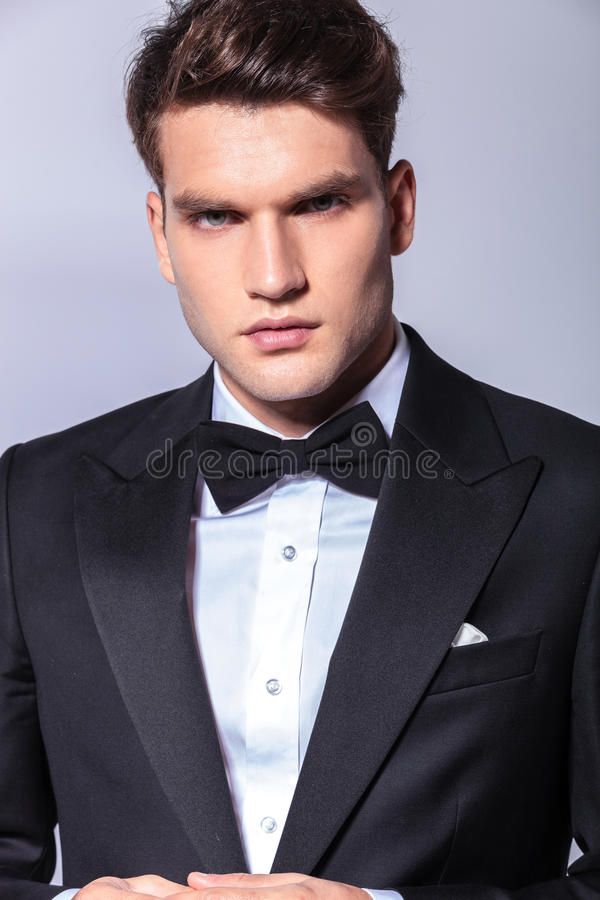 Close up portrait of a young handsome business man. Wearing a tuxedo royalty free stock photos