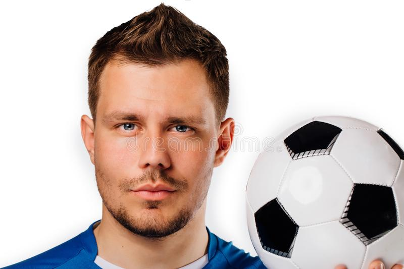 Close-up portrait of young handsome football player soccer posing on white isolated. royalty free stock images