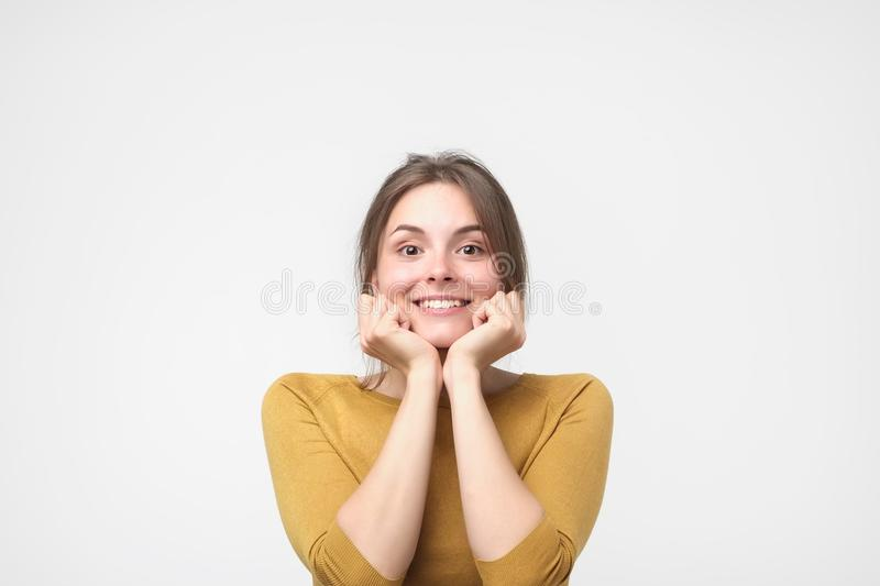 Close up portrait of young happy caucasian woman on white background stock photo