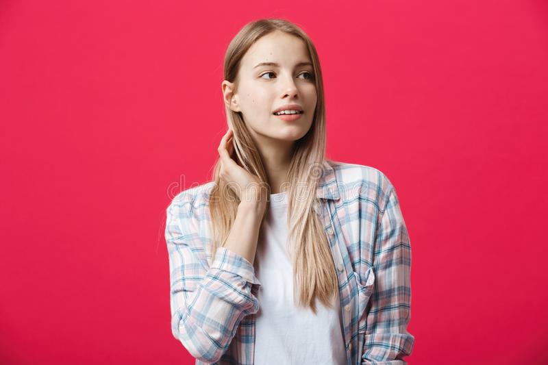 Close up portrait of young happy woman on pink background stock photos