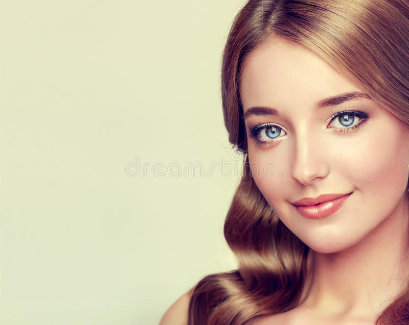 Close-up portrait of young Lady with elegant hairstyle. And colorful make up. Nice, tender and kind smile stock photo