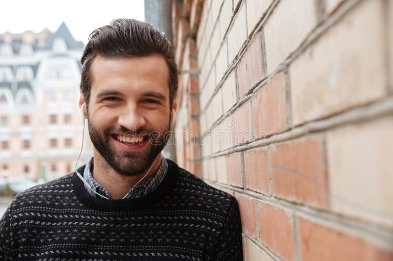 Close up portrait of a young laughing man stock photography
