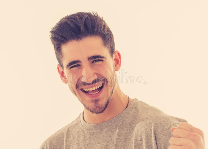 Close up portrait of young man with excited facial expression surprised of success stock photography