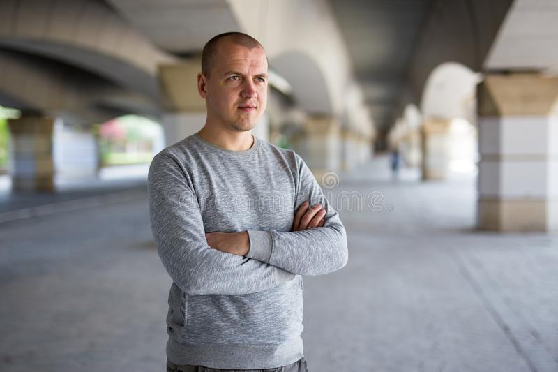 Close up portrait of young man posing under the bridge royalty free stock images