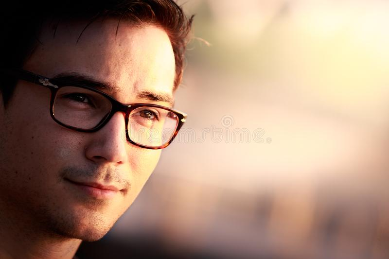 Close up portrait of young man wearing glasses stock images