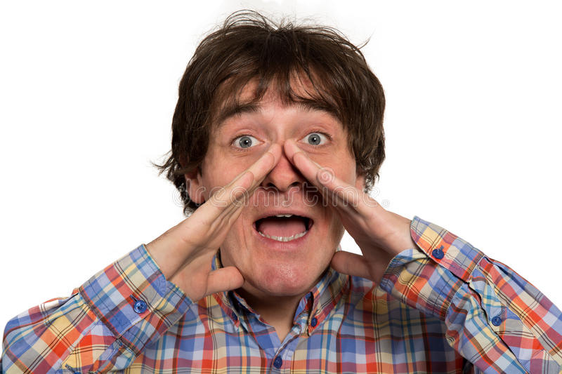 Close up portrait of young man yelling with open mouth royalty free stock image