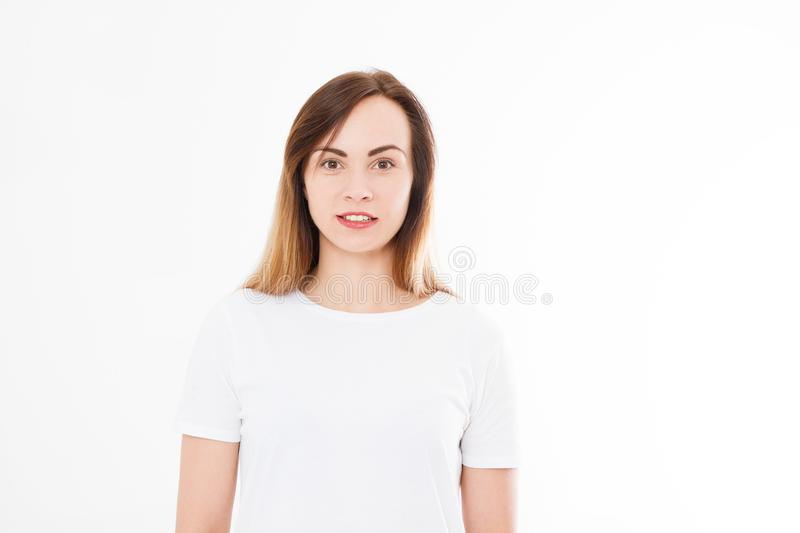 Close-up portrait young pretty woman smiling in white t-shirt on white background, happy, positive mood, isolated, sincere smile. stock photo
