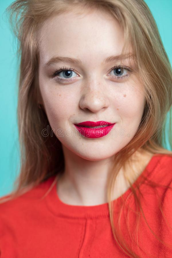 Closeup portrait of a young redhaired woman. Beautiful girl with red lips looking at camera stock photos