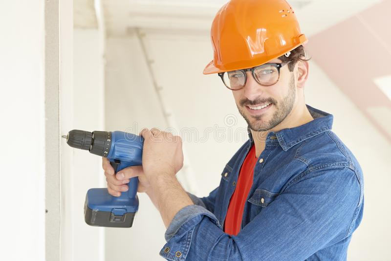 Handyman holding hammer drill driver royalty free stock image
