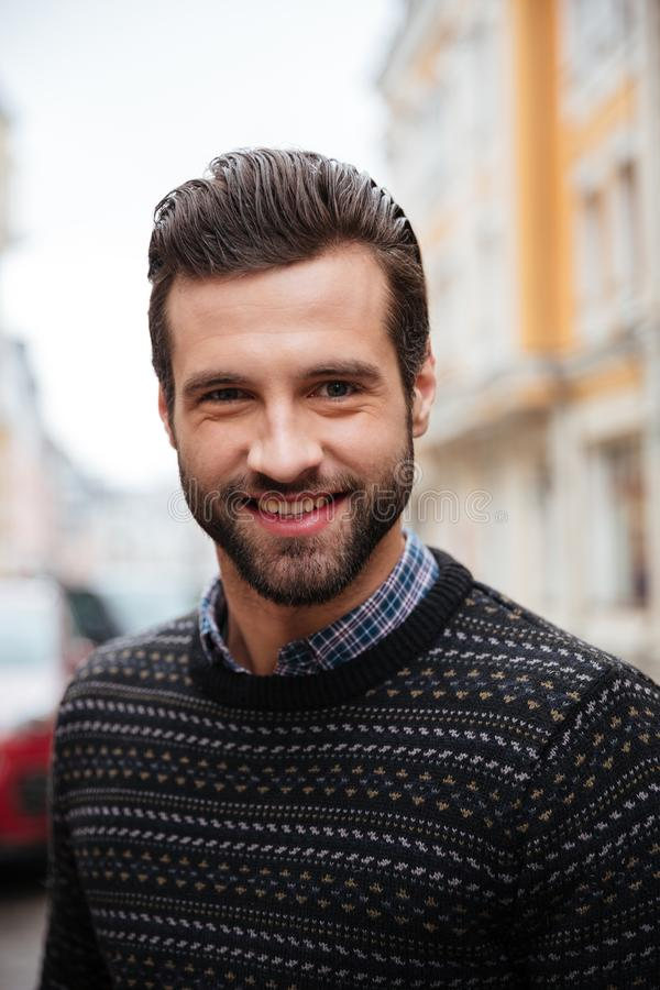 Close up portrait of a young smiling man stock image