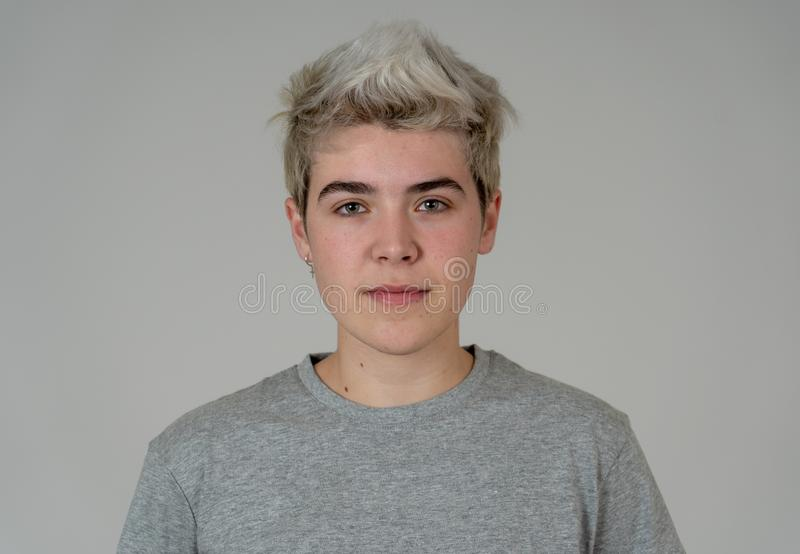 Natural portrait of young handsome transgender boy posing with neutral face expression stock photo