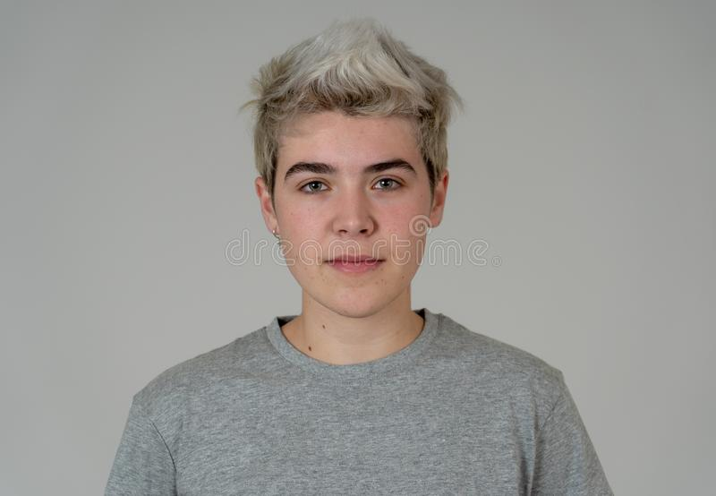 Natural portrait of young handsome transgender boy posing with neutral face expression stock photography
