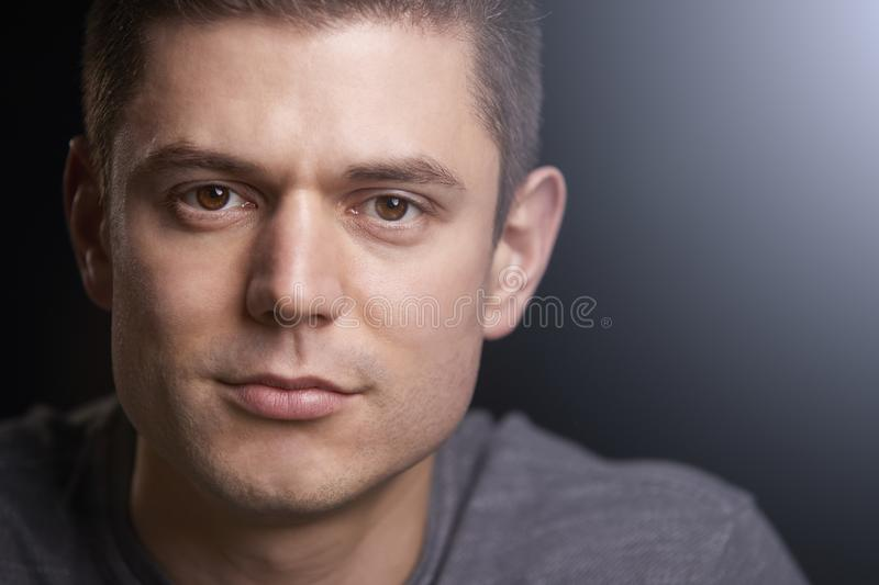 Close up portrait of a young white man looking to camera stock photo
