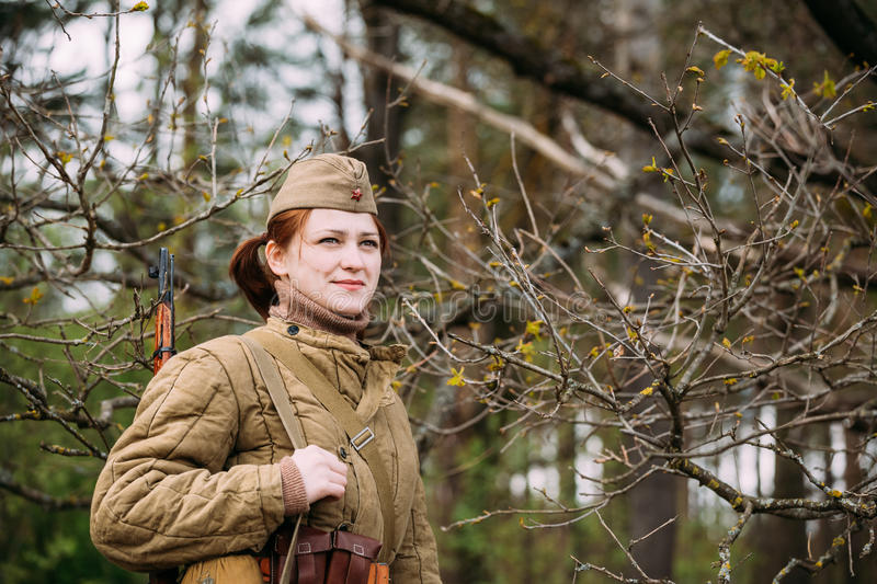 Close Up Portrait Of Young Woman Re-enactor Dressed As Russian Soviet Infantry Soldier Of World War II In Forest. Pribor, Belarus - April 23, 2016: Close Up stock photography