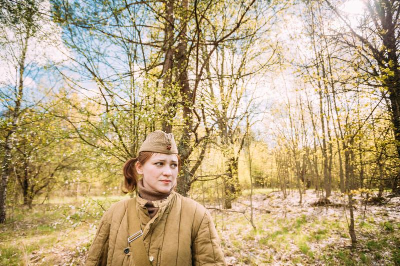 Close Up Portrait Of Young Woman Re-enactor Dressed As Russian Soviet Infantry Soldier Of World War II In Forest. Pribor, Belarus - April 23, 2016: Close Up stock image