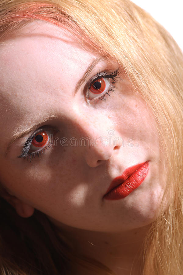 Close-up portrait young woman with red eyes