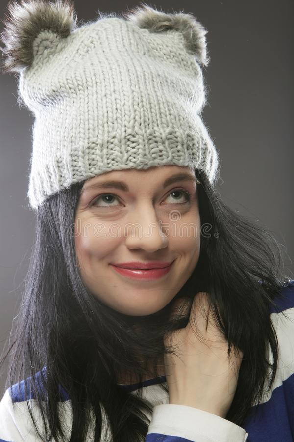Close up portrait of young woman wearing funny hat. Over grey background royalty free stock photos