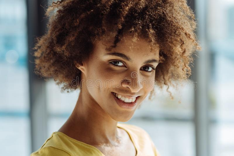 Close up of positive curly afro american woman stock images