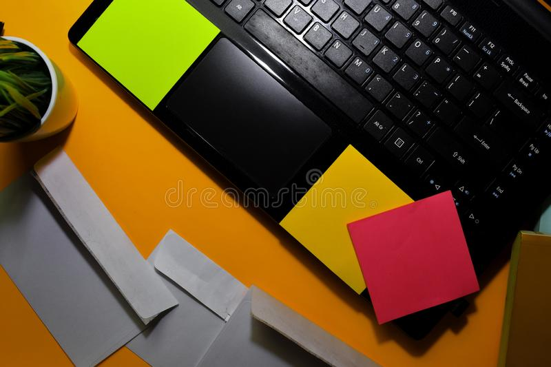 Close up Post card and laptop isolated on office desk background royalty free stock photography