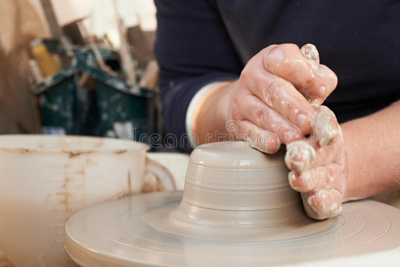 Close Up Of Potter Moulding Clay On Wheel. Potter Moulding Clay On Wheel royalty free stock photography