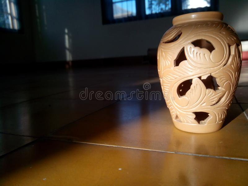 Close up pottery brown color with light royalty free stock photography