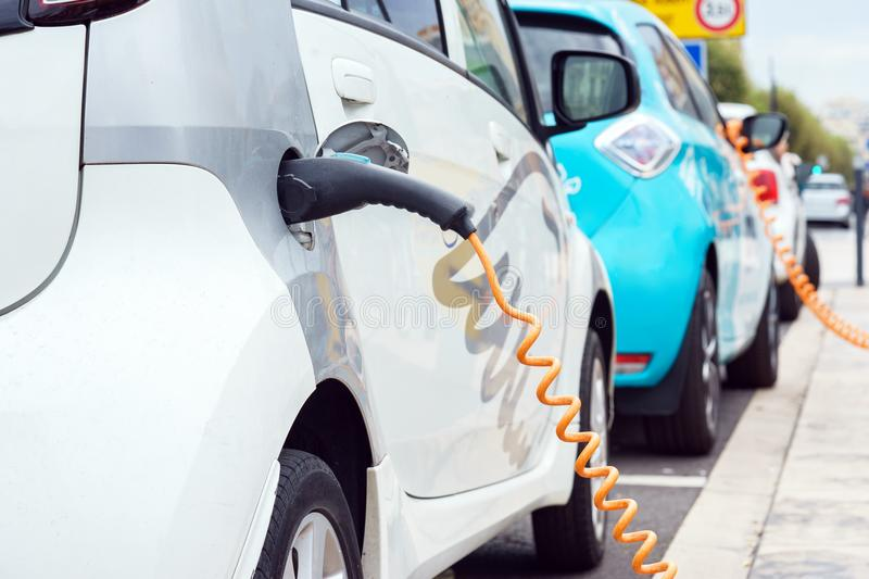 Close up of electric car being charging royalty free stock photography