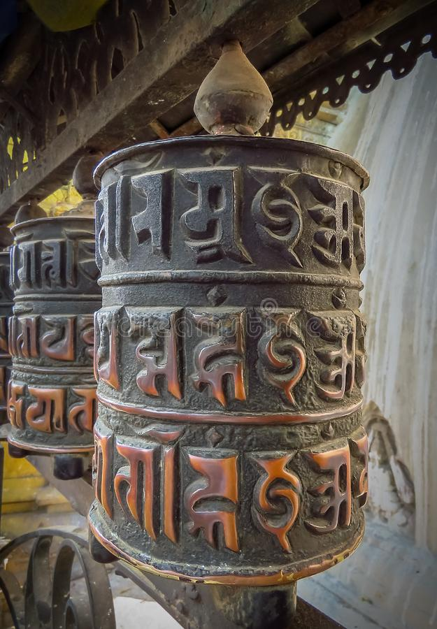 Prayer wheel at Swayambhunath Temple aka Monkey Temple, Kathmandu, Nepal. Close up of prayer wheel at Swayambhunath Temple aka Monkey Temple, Kathmandu, Nepal royalty free stock image