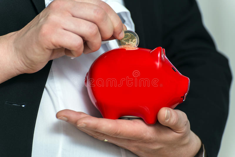 Close Up Pregnant Business Womans Hands With Piggy Stock Photo