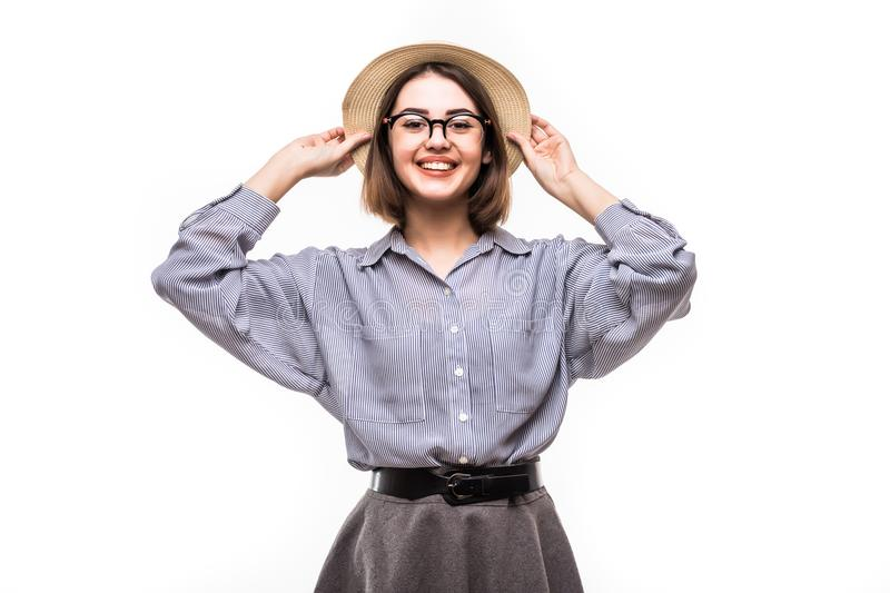 Portrait of pretty joyful girl in straw hat ready for journey posing in studio over white background. stock images